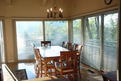 Picture windows and dining table